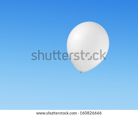 White balloon flying in the sky - stock photo