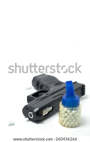White balls with airsoft gun  isolated on white - stock photo