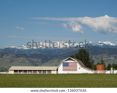 White barn with painted American Flag in Colorado. - stock photo