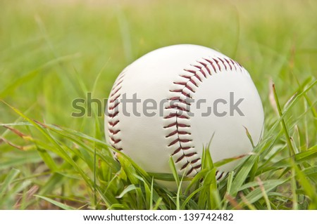 white baseball on the green grass field
