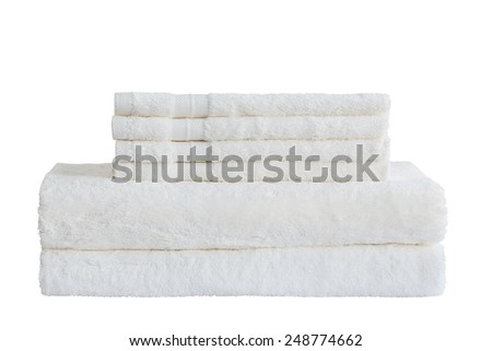 White bath towels in stack. Isolated over white - stock photo