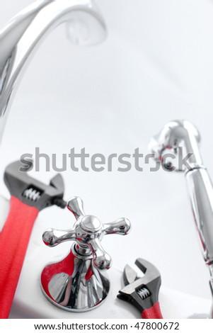 White bath. Wrench. Plumbing. Plumber tool - stock photo