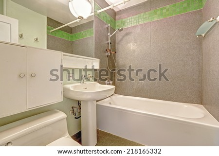 White bathroom interior with grey wall and green tile trim