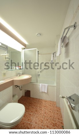White Bathroom with mirror, sink, bath, toilet in hotel