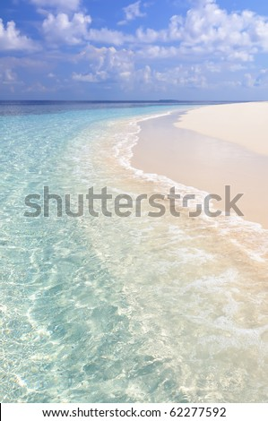 White beach, turquoise sea and light clouds on a paradise island in Maldives. - stock photo