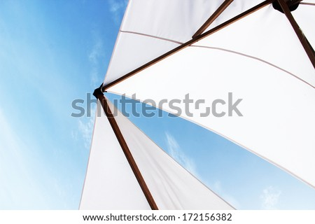 white beach umbrella or sail on a yacht with blue sky