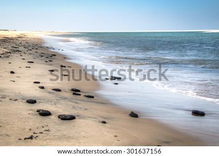 White beach with rocks on the Bazaruto Islands near Vilanculos in Mozambique  - stock photo