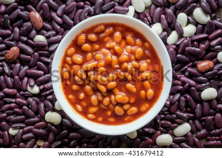 White beans in tomato sauce on mix differences beans background. Typical dish and cuisine from the Peru. - stock photo