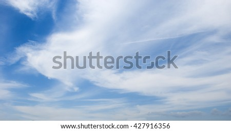 White beautiful clouds in the blue sky with little wind