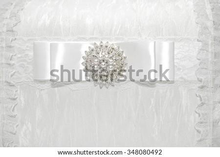 White beautiful wedding background. Lace wedding decoration. Element of stylish white gift box. - stock photo
