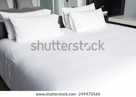 White bed sheets and pillows - stock photo