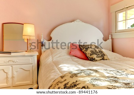 White bed with pink walls interior design. - stock photo