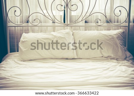 white bedding sheets and pillow, vintage tone  - stock photo