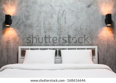 white bedroom with gray cement wall - stock photo