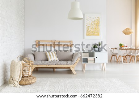 White, beige and gold furniture and decorations in living room