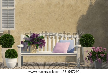 white bench and spring lilac flowers  - stock photo
