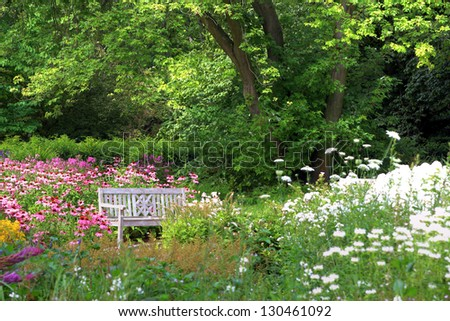 white bench in a beautiful garden - stock photo