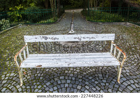 white bench in the  autumn park - stock photo