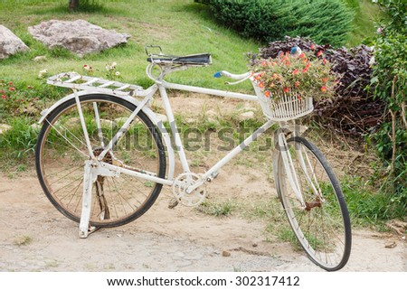 white bicycle in garden - stock photo