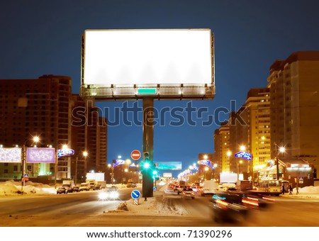 White big empty billboard on night street - stock photo