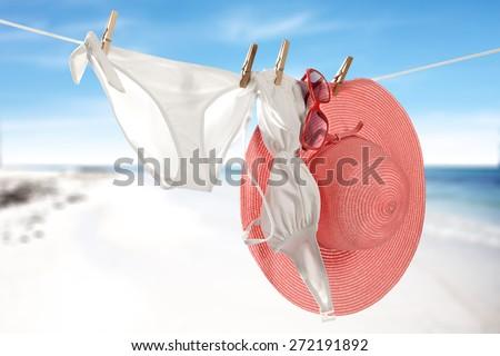 white bikini on rope and pink hat  - stock photo