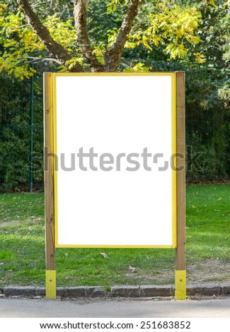 White billboard at the park with space for your advertisement - stock photo