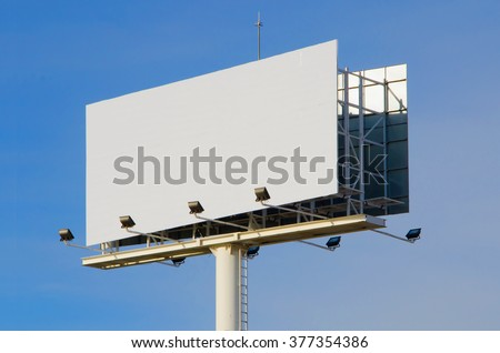 White billboard with cloudy sky on background. Advertising, marketing and promotion element. Blank mockup - stock photo