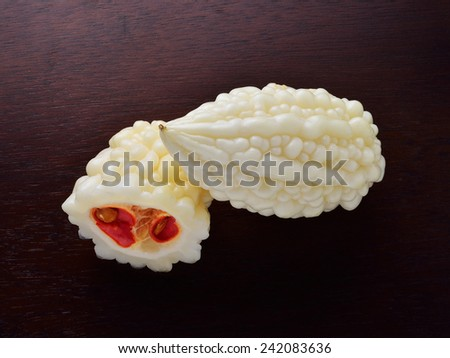 White bitter cucumber on wooden background