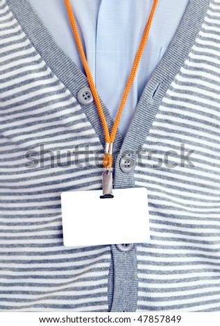 White Blank Badge with an orange strap on mens torso - stock photo