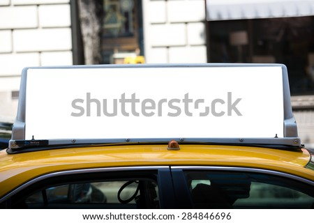 White blank billboard on the taxi roof. Yellow cab in New York City. - stock photo