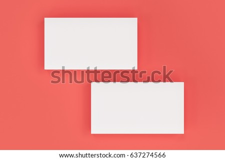 White blank business cards mock-up on red background. Corporate stationery template. 3D rendering illustration