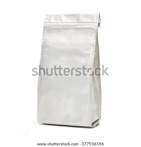 White blank glossy foil food bag on white background including clipping path  - stock photo