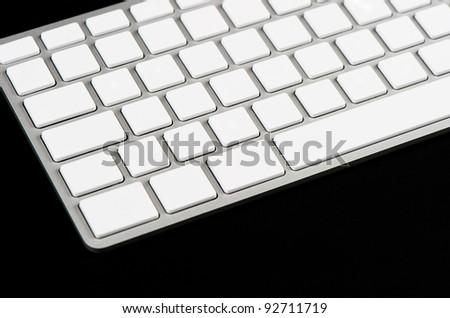 white blank keyboard on black background - stock photo