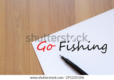 White blank notepad on office wooden table and text concept - stock photo