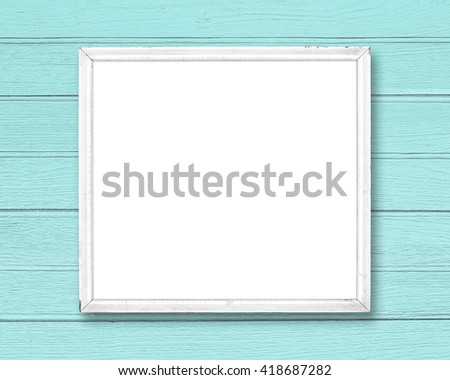 White blank old picture frame on blue wood wall. - stock photo