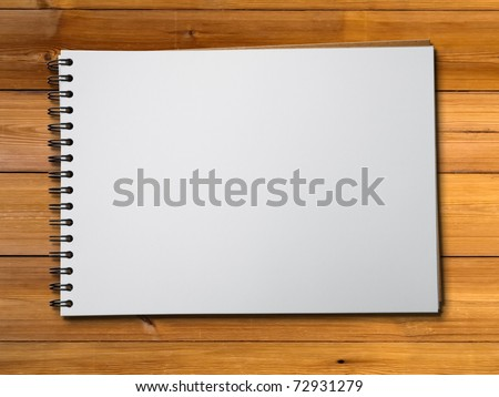White blank page sketch book on wood table horizontal - stock photo