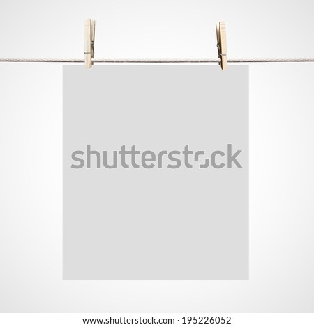 white blank paper hanging on clothespins
