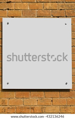 White Blank Poster in brick wallTemplate Mock up for your content - stock photo