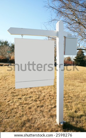 White blank real estate sign in front yard on golden grass - stock photo
