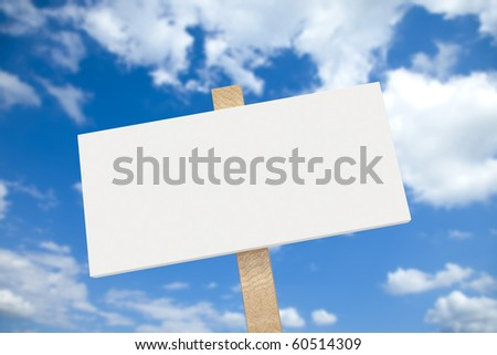 White blank sign on a wooden post