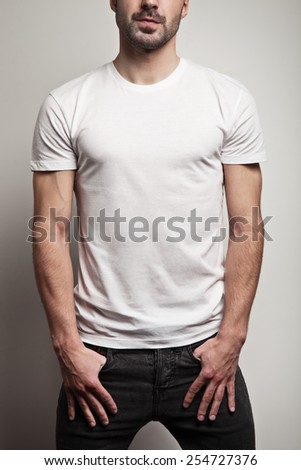 White blank t-shirt on young and handsome man, front