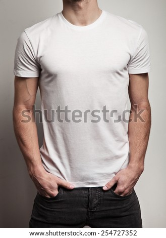 White blank t-shirt on young man, front - stock photo