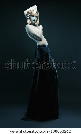 white blond woman in long skirt - stock photo