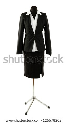 White blouse and black skirt with coat on mannequin isolated on white - stock photo