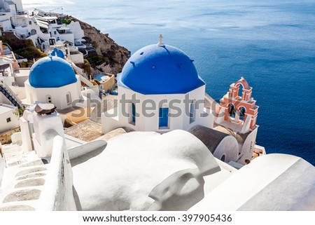 White-blue church in Oia, Santorini island, Greece - stock photo