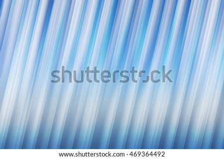 White blurred rays of light blend to create abstract background