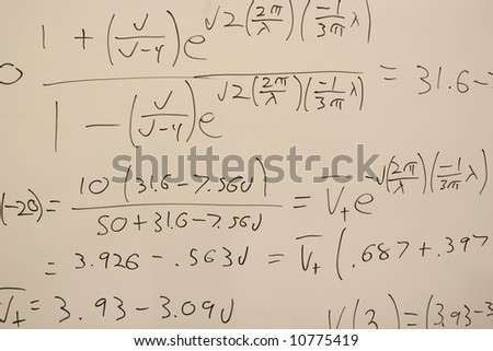 White board with handwritten science equations written in marker - stock photo
