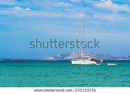 white boat alone in the sea. Shot in Sardinia, Italy - stock photo