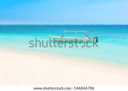 White boat at the beach of archipelago Los Roques, Venezuela - stock photo
