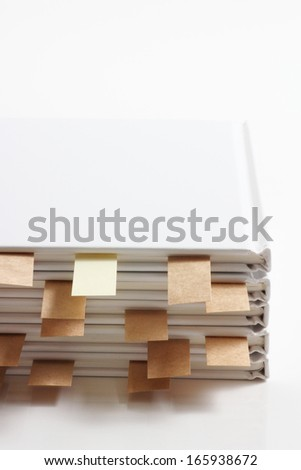 White book with sticky bookmarks